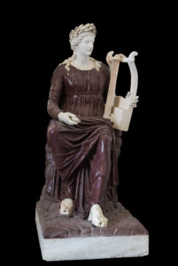 Apollo seated with lyre wearing laurel wreath.