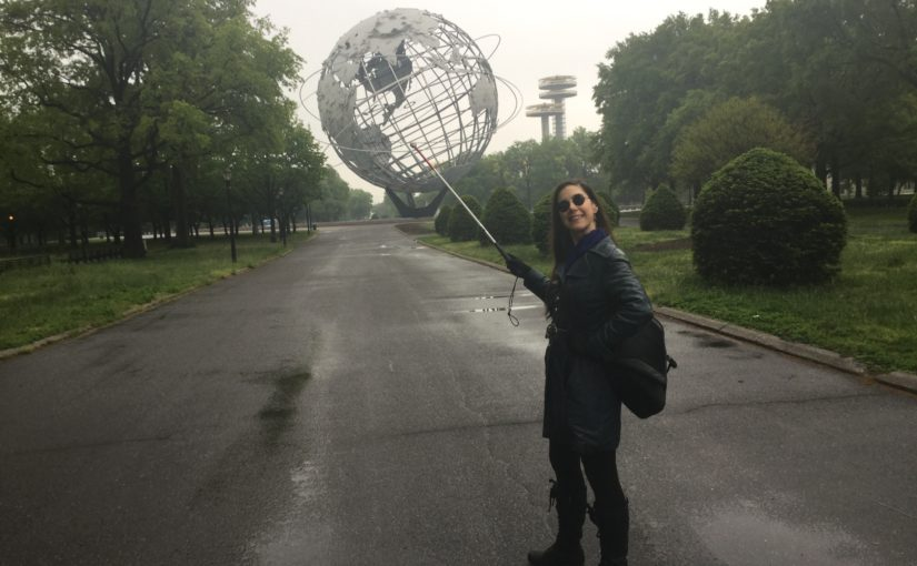 Blind writer Godin points with her blind person cane at The Unisphere, Queens Museum, New York